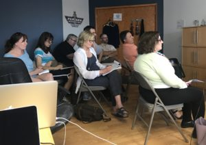 Photo of attendees listening to presentation